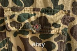 Beige vintage military jumpsuit with camouflage pattern