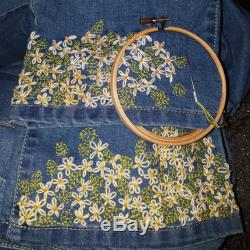 Hand embroidered lazy daisy floral jeans