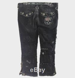 Mangler distressed black jeans by Chad Cherry