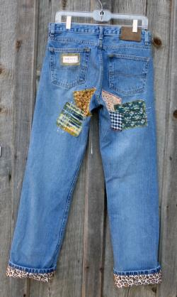 Patched embroidered hippie boho designer five pocket classic cut jeans size 34 x 33