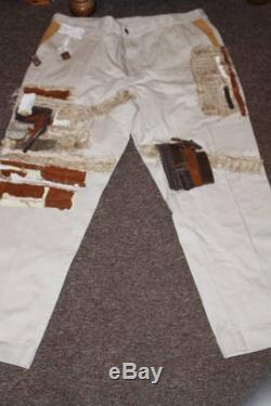 Unisex ,unique upcycled patchwork cream jeans. Bohemian hippie style .