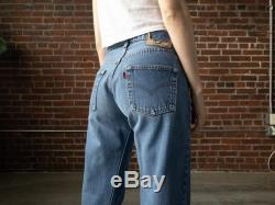Vintage Levis Redlines Size 2 4 With 28 Inch Waist 80s Selvedge Levi 501 Fly Blue Jeans With Raw Fraying Hem USA Cotton Denim
