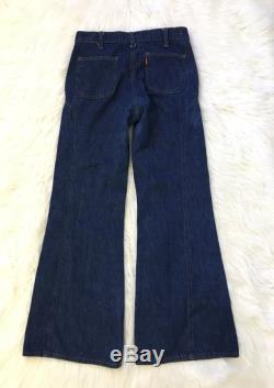 Vintage orange feather tab Levis 25 26
